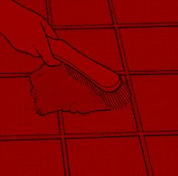 Fugen masse aus feinem Mörtel fegen Sie mit einem Handbesen in die Fugen ein